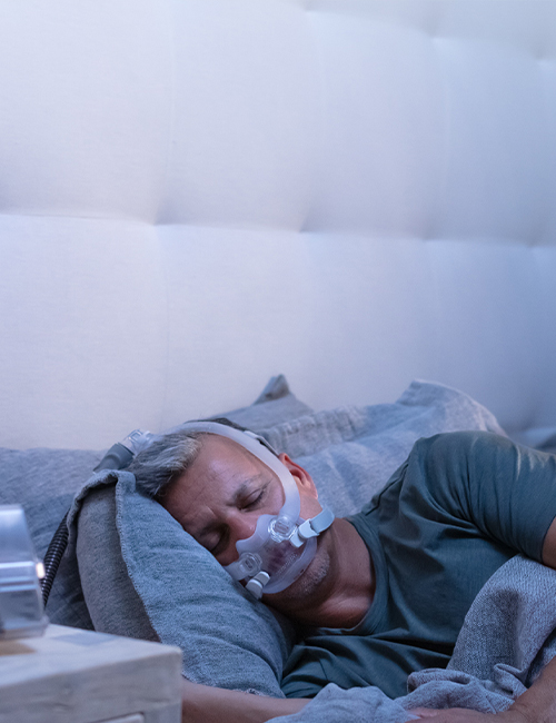 patient-sleeping-with-AirFit-F30i-tube-up-CPAP-mask-mobile